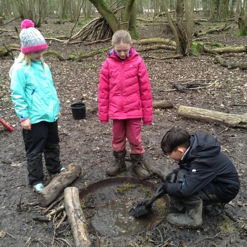 Emily, Chloe and Hugo light our camp fire