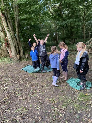 Boys succeeded flipping tarpaulin