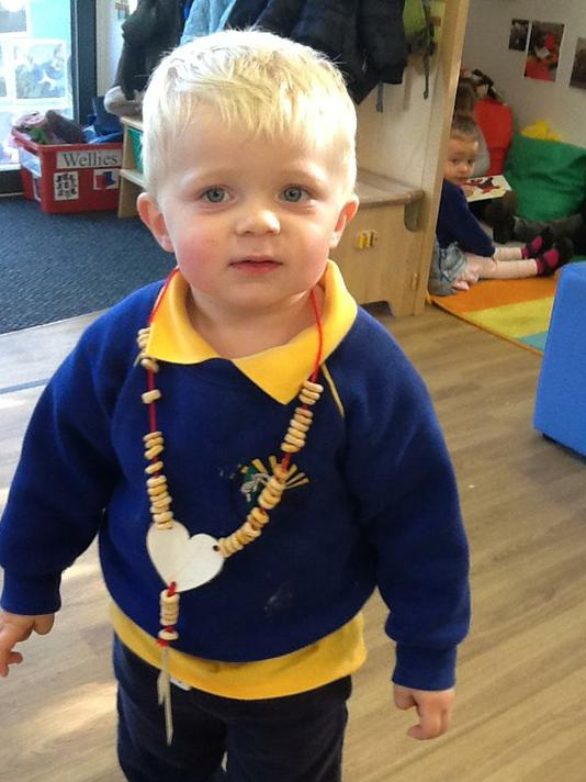 We made our own Rosary bead necklace