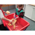 Pouring and scooping whilst counting ducks