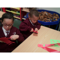 Making poppy medals for Remembrance Day