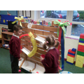 Using our giant marble run.