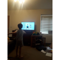 Harry exercising with Joe Wicks
