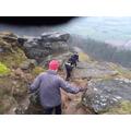 Clambering down rocky terrain