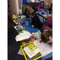 Class 5 investigating how quickly sugar dissolves in different temperatures of water.