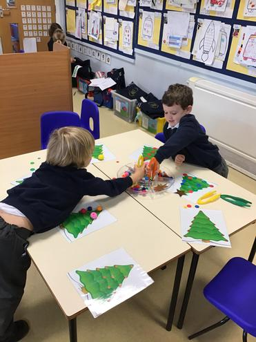 Decorating a Christmas tree using our fine motor skills