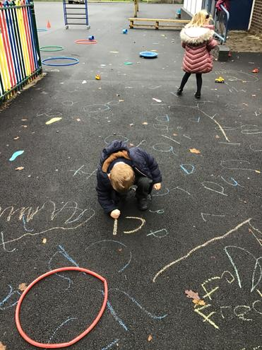 Chalking in the playground some of the sounds we have learnt this week