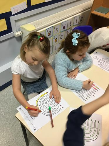 We learnt about Hanukkah and coloured in a menorah