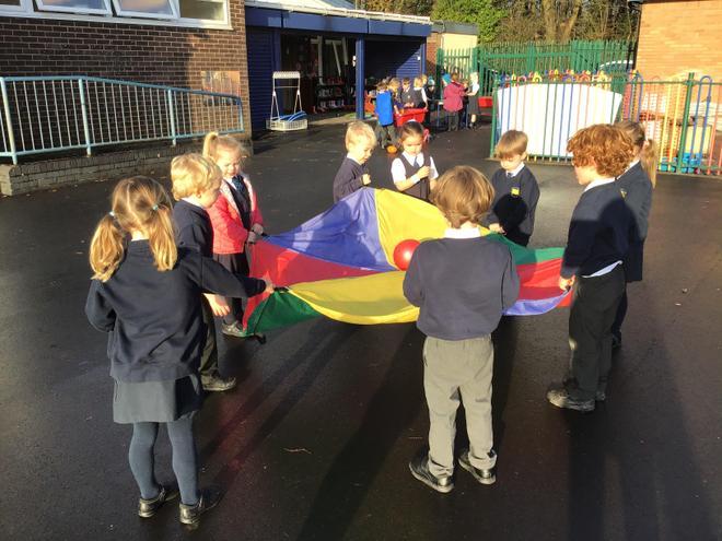 What fun we had balancing balls on the parachute.