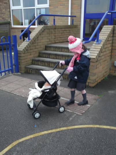 Taking baby for a walk.