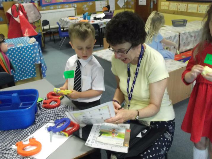 Mrs Shaw brings the books to us.