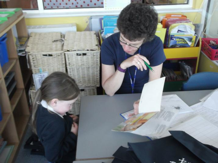 Mrs Shaw gives us a reading book.