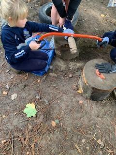 Children taking part in Forest School activities.