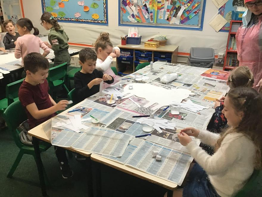 Swans class busy completing their Christmas art