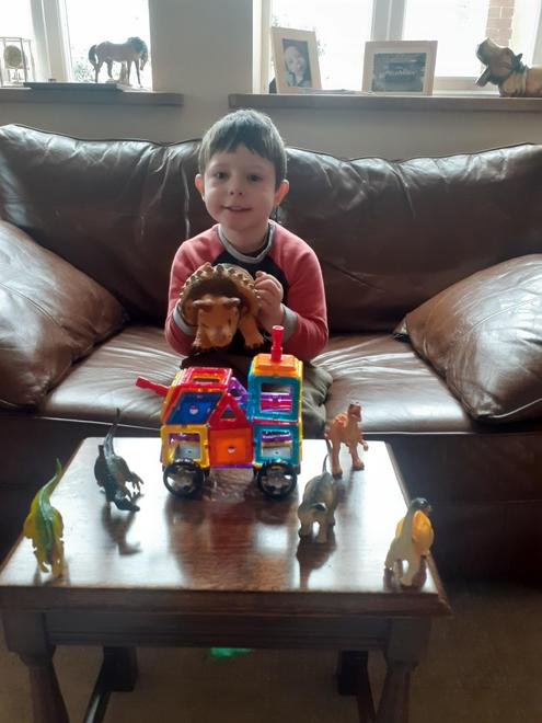 My dinosaurs and a vehicle that I made for them!