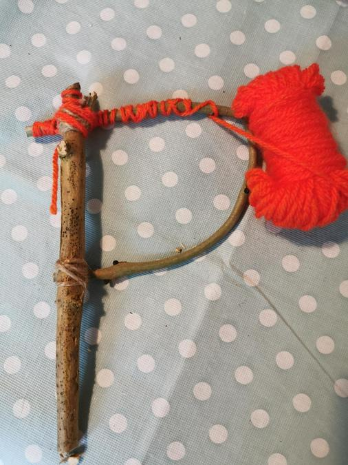 Tie the wool and wrap around twig
