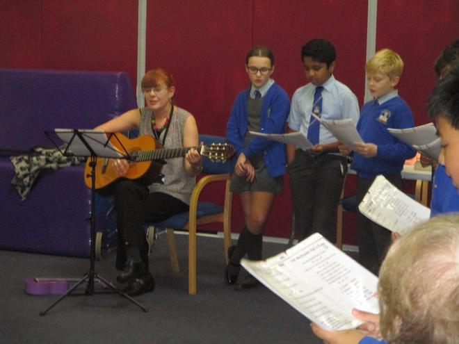 Accompanied by the guitar and ukulele.