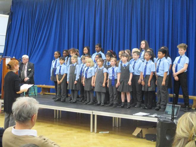 The choir sang 4 songs.