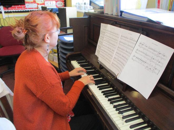 Mrs Walton at the piano.