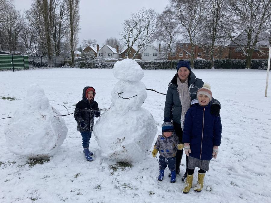 Having fun in the snow and building a massive snowman!