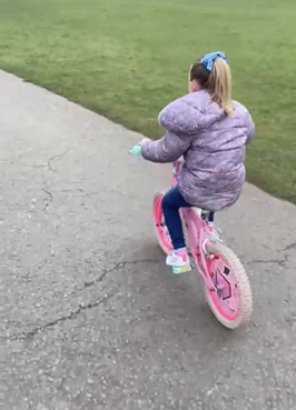 Libby (Yr 2) learnt how to ride her bike!