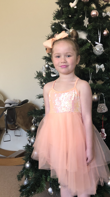 Reeva (Reception) passed her dancing exam and is waiting to recieve her medal! Well done!