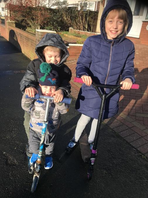 Enjoying riding scooters and playing outside!
