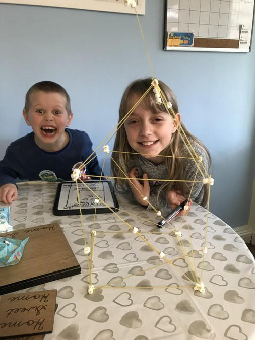 Building a structure out of spagetti and marshmallows!