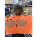 We drew fruits in baskets and added to find the total