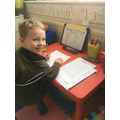 Leo working hard at his maths.