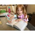 Elizabeth doing her maths work. Well done.