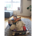 Finley enjoying his reading in his homemade boat!