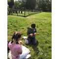 Bettsy and her brother making daisy chains