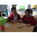 Ava M. and Evie during a science teeth experiment