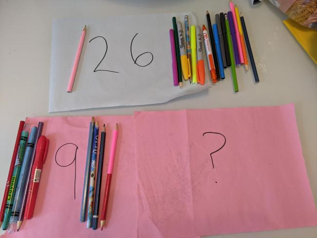 We know 9 is a part so we take 9 of the 26 pencils and place on the 9 part.
