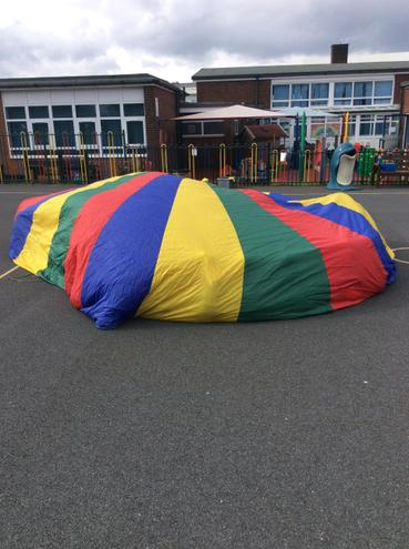 The children all hid under the parachute!
