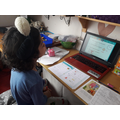 Isaac working hard on fractions - brilliant!