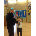 PC Woodmansee showing how he uses his handcuffs.