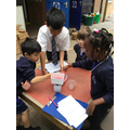 Year 5 helping year 1 with their space mission