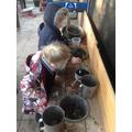 Mud pies being made