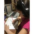 Super Sadie doing Maths