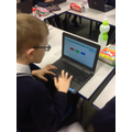Making equivalent fractions online.