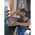 Madison making Unicorn sprinkle cookies - yum