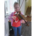 Edith has been making sure to keeps on being musical by practising the violin regularly!