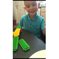 Roman having fun building with Stickle bricks