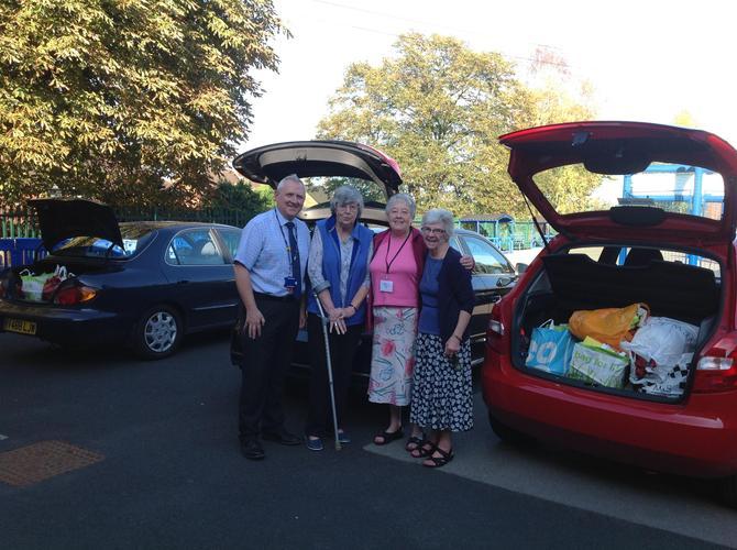 Breaking Bread volunteers collect harvest gifts!