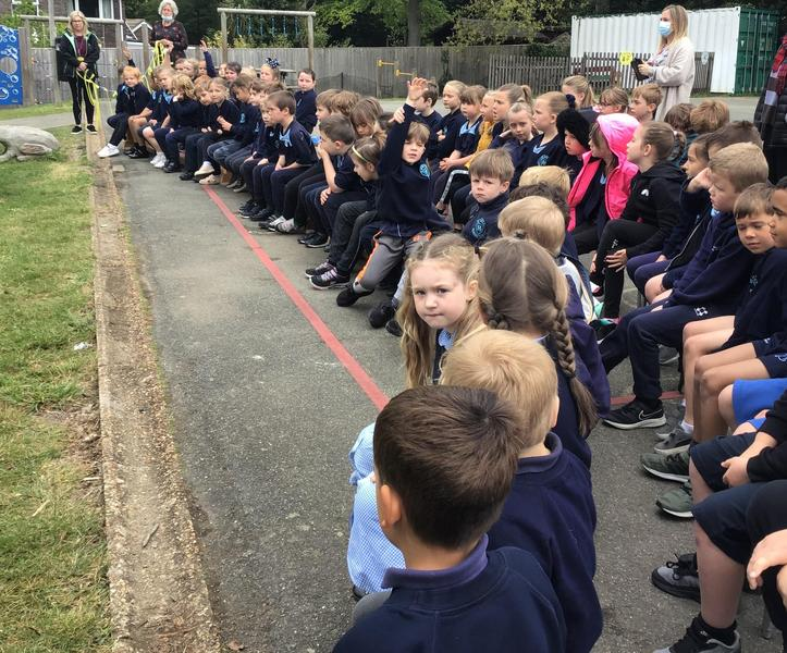 Reception and KS1 listening to the service of re-dedication
