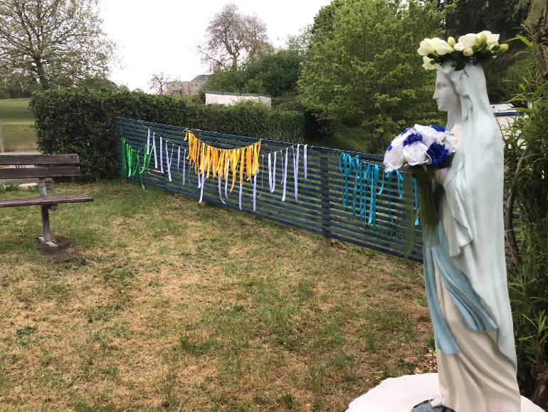 We thought of some things to thank Our Lady for and wrote them on ribbons.