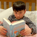 Joseph reading during world book night