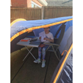 Abbie working in her tent